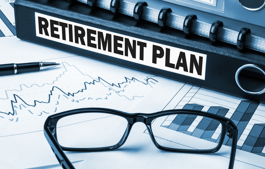 Retirement-plan-with-graphs-and-glasses-on-desk.jpg